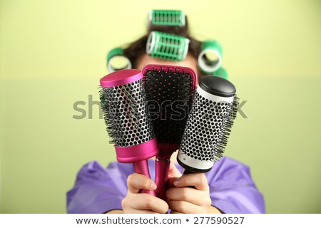 Funny woman with hair rollers and brush Stock photo © photography33