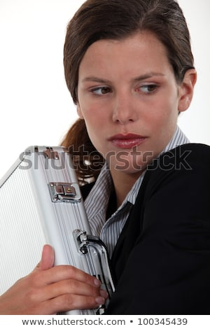 Businesswoman nervously holding metal briefcase Stock photo © photography33
