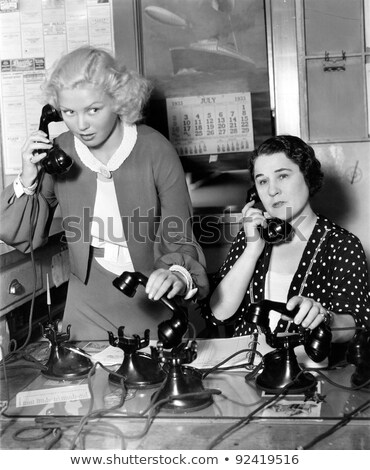 Woman chatting on an old fashioned telephone Stock photo © stryjek