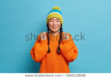 Girl Keeping Warm With A Knitted Jumper And Hat Stock photo © stuartmiles