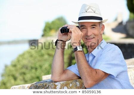Starszy dżentelmen widoku lornetki człowiek lata Zdjęcia stock © photography33