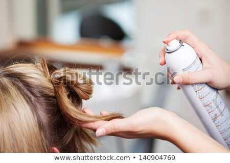 Blond woman using hair spray Stock photo © photography33