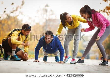 Fitness man in park making push ups Stock photo © dash