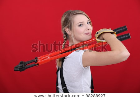 Woman holding bolt cutter Stock photo © photography33