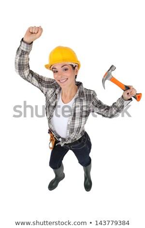 Mason jubilant women with hammer in hand Stock photo © photography33