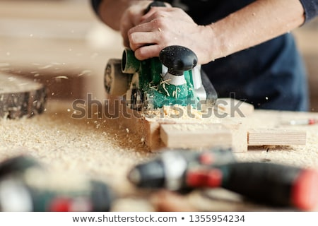 Man using wood plane Stock photo © photography33