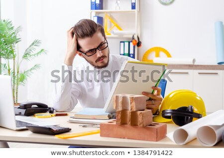 A construction worker taking notes. Stock photo © photography33