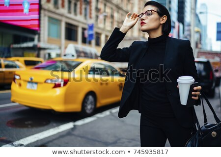 Young woman hailing a cab Stock photo © photography33