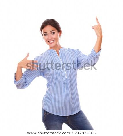 élégant jeune femme pointant up regarder bleu Photo stock © pablocalvog