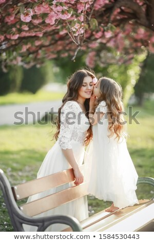 Bride and her bouquet in the park. Stock photo © justinb