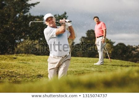 Senior jogador de golfe areia armadilha bola fora Foto stock © Kzenon