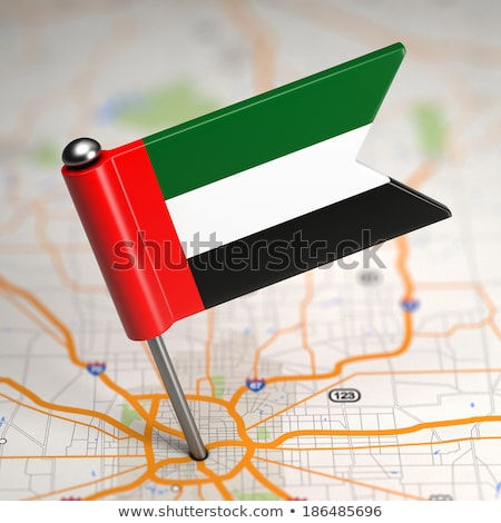 UAE Small Flag on a Map Background. Stock photo © tashatuvango