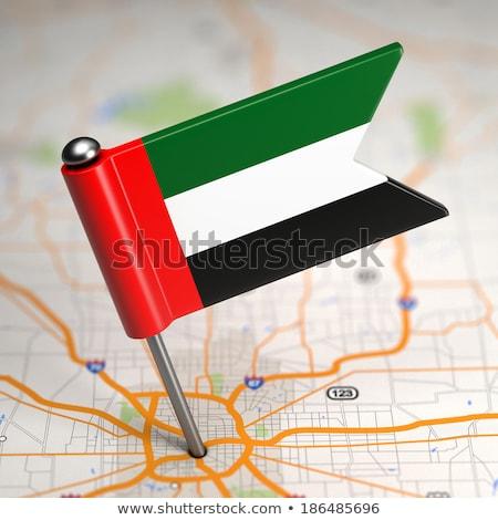 UAE Small Flag on a Map Background. Stock photo © tashatuvango