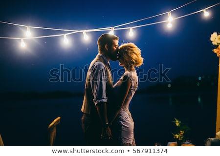 Young couple standing near water Stock photo © dariazu