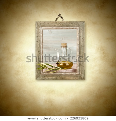 olive oil in glass jar picture hanging stock photo © marimorena