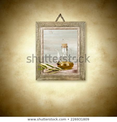 Olijfolie glas jar foto opknoping muur Stockfoto © marimorena