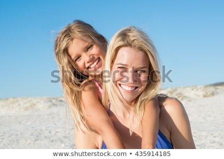 moeder · dochter · zwemmen · zee · familie · kinderen - stockfoto © phbcz