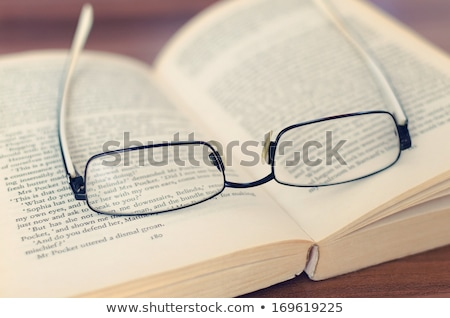 book and glasses on table in library stock photo © valeriy