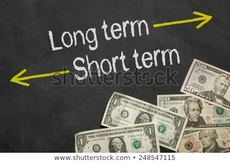 Text on blackboard with money - Long term and short term Stock photo © Zerbor