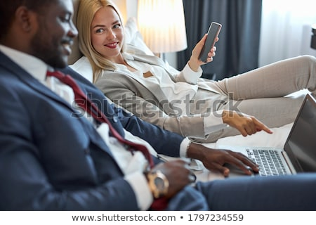 romantic blonde woman posing in bed stock photo © neonshot