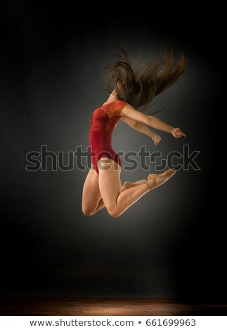 Side view of pretty brunette with arms outstretched  Stock photo © wavebreak_media