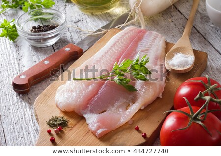 Perch fish fillets on a wooden filleting board Stock photo © Mps197