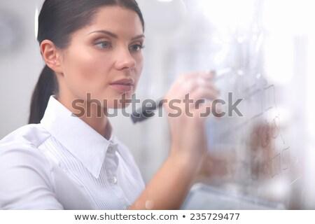 businesswoman drawing on wihteboard stock photo © alphaspirit