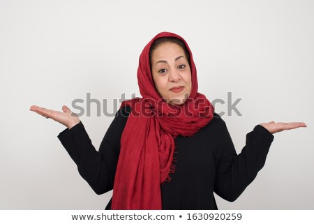 casual woman shrugging shoulders stock photo © deandrobot