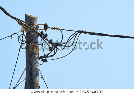 power poles with many wires Stock photo © Klinker