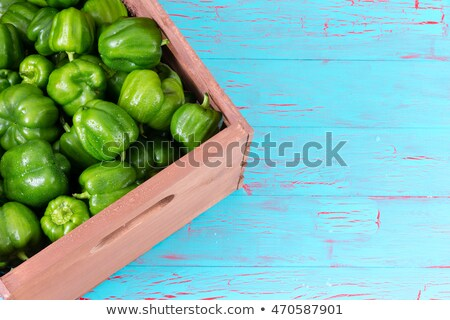 Corner of crate fully stocked with green peppers Stock photo © ozgur