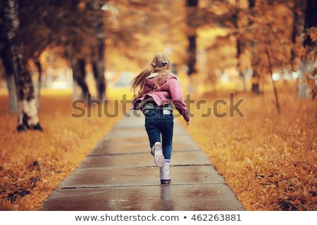 A young girl running Stock photo © bluering