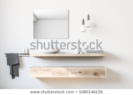 Stock photo: metal faucet on white sink in bathroom