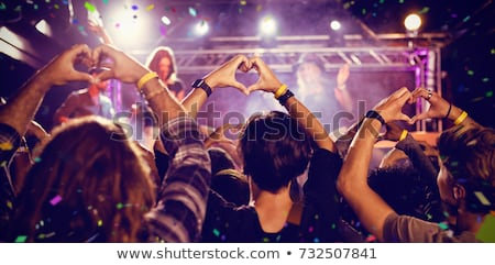 Fans making heart shape with hands during performance Stock photo © wavebreak_media