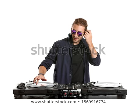 Portrait of young male dj with headphones at nightclub Stock photo © wavebreak_media
