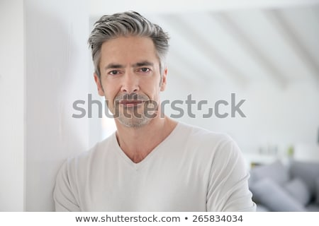 Senior man standing with arms crossed at home Stock photo © wavebreak_media