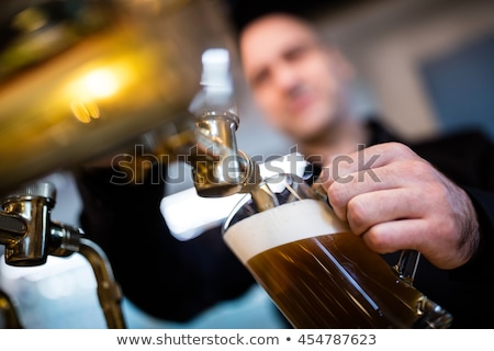 заполнение пива стекла насос Бар кофе Сток-фото © wavebreak_media