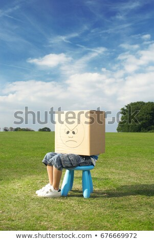 young boy on stool with box on head stock photo © is2