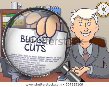 Budget Cuts through Magnifier. Doodle Style. Stock photo © tashatuvango