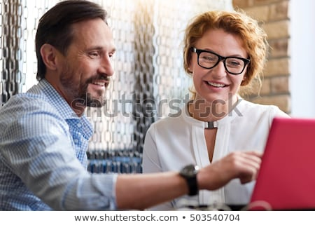 Happy middle-age man pointing Stock photo © alexandrenunes