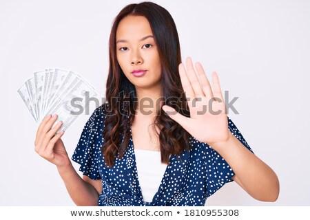 Asya kadın dolar işareti el iş takım elbise Stok fotoğraf © studioworkstock