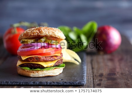 Fresh red onion over black Stock photo © deandrobot