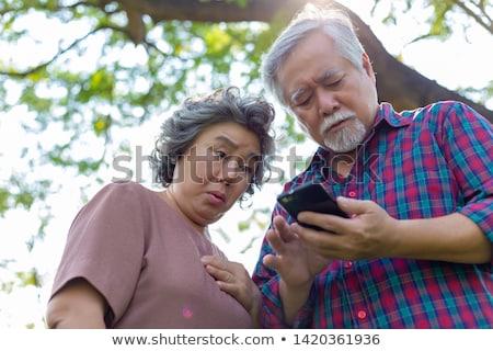 senior · mulher · assustado · mulheres · luz · azul - foto stock © FreeProd
