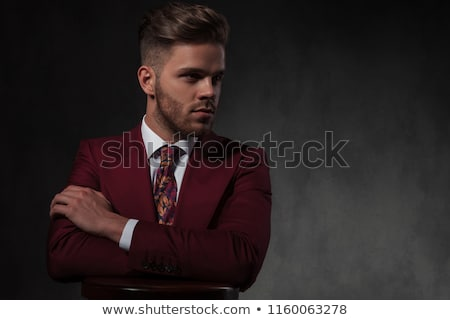 unshaved businessman relaxing on wooden stool looks to side Stock photo © feedough