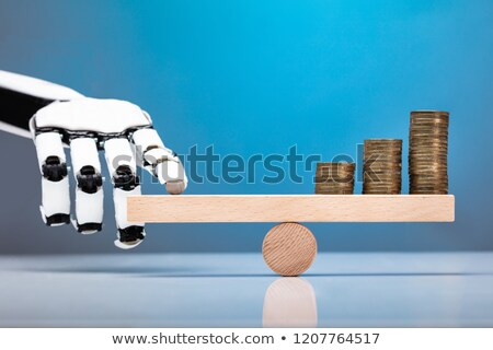 Robot Balancing Stacked Coins With Finger On Seesaw Stock photo © AndreyPopov