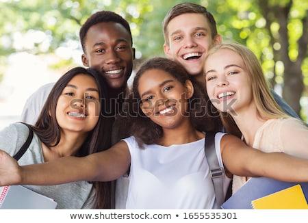 グループ 幸せ 十代の 学生 徒歩 屋外 ストックフォト © dolgachov