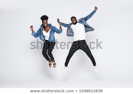 Portrait of an excited young afro american man Stock photo © deandrobot
