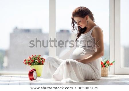 embarazadas · cute · mujer · tocar · vientre · habitación - foto stock © lopolo