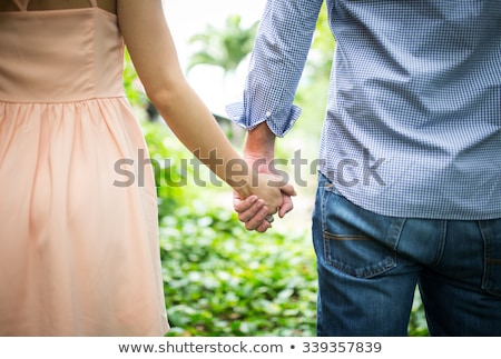 feliz · amor · casal · de · mãos · dadas · manhã · ao · ar · livre - foto stock © ruslanshramko