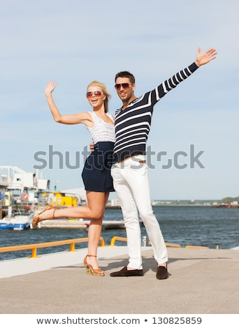 couple in sunglasses hugging and waving hands Stock photo © dolgachov