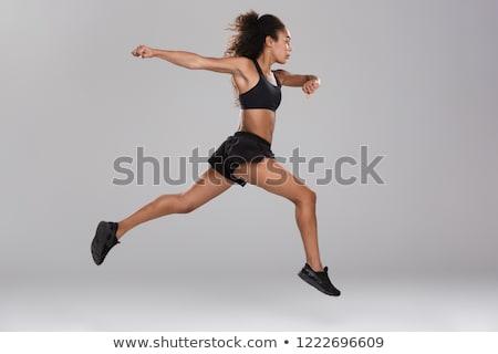 Incredibile bella forte sport donna jumping Foto d'archivio © deandrobot